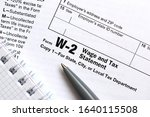 the pen and notebook on the tax ... | Shutterstock . vector #1640115508