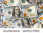 a pile of one hundred us... | Shutterstock . vector #1640117002