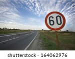 road sign speed limit sixty... | Shutterstock . vector #164062976