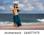 a beautiful  happy hula dancer... | Shutterstock . vector #164077475