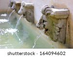 Water Flow From Lion Statue On...