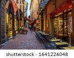 Old narrow street in Bologna, Emilia Romagna, Italy. Architecture and landmark of Bologna. Cozy cityscape of Bologna.