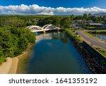 Aerial shot of the river anahulu and the twin arched road bridge in the North Shore town of Haleiwa