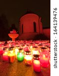 Small photo of St. Peter chapel on Ljubljana's central cemetery Zale lit by candlelight on a remembrance day, Slovenia