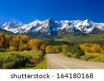 Countryside road, fall season in Colorado - stock photo