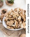 heap of walnuts  close up shot  | Shutterstock . vector #164203406