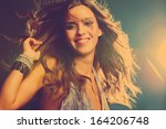 Stock photo smiling young girl dancing in night club retro colors 164206748