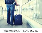 traveler with a suitcase on the ... | Shutterstock . vector #164215946