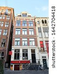 Small photo of Amsterdam, Netherlands - June 30, 2019: The historic city center. Old town houses