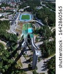Aerial View of Ski Jump in Lahti City, Finland. On the background stadium.
