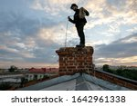 Chimney sweep young man with...