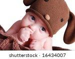 a cute baby boy sucking his... | Shutterstock . vector #16434007