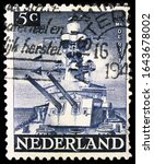 "Small photo of MOSCOW, RUSSIA - OCTOBER 8, 2019: Postage stamp printed in Netherlands shows Cruiser ""De Ruyter"", Liberation Liberation serie, circa 1944"