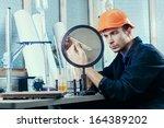 laboratory worker in helmet... | Shutterstock . vector #164389202