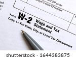 the pen lies on the tax form w... | Shutterstock . vector #1644383875