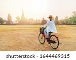 Woman Riding A Bicycle With...