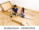 furniture assembling by asian... | Shutterstock . vector #164461016