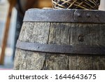 Old wooden barrel on a brown...
