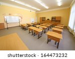 empty classroom with wooden... | Shutterstock . vector #164473232
