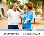 Elderly Couple Enjoys Victory...