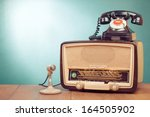 Stock photo retro radio with green light microphone and telephone on wooden table 164505902