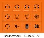 headphones icons on orange...