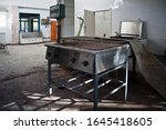 Abandoned And Ruined Kitchen O...