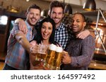 group of happy young friends...   Shutterstock . vector #164597492
