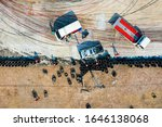 Small photo of Aerial top view Crash cars drifting battle on race track