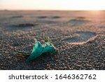 Plastic Container On Sandy Sea...