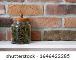 Jar With Thyme On A White...