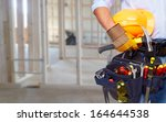 worker with a diy tool belt... | Shutterstock . vector #164644538