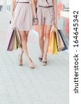 outdoor shot of two women... | Shutterstock . vector #164645342