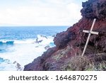 Small photo of Maui, Hawaii - February 2020: A memorial overlooks a scenic but slippery and dangerous area of cliffs on Maui where visitors have fallen to their death previously.