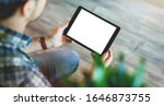 Mockup Of A Man Holds Tablet...