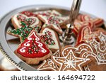 Gingerbread cookies decorated with icing and sprinkles for Christmas - stock photo