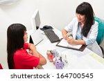 patient consulting her teet... | Shutterstock . vector #164700545