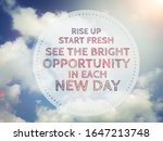 Small photo of Rise up Start fresh See the bright opportunity in each new day word in round on blue cloudy sky background