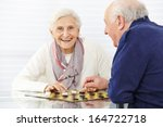 happy senior couple playing... | Shutterstock . vector #164722718