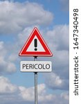 Small photo of A sign with a exclamation mark warning for a dangerous situation ahead and a smaller sign below with the Italian word Pericolo on it, meaning danger in English