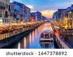 Naviglio Grande canal in Milan city, Italy, a popular tourist area, on dramatic sunset