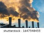 Industrial Chimneys Spewing...