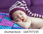 cute newborn baby sleeps in a... | Shutterstock . vector #164757155