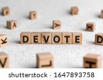 Small photo of Devote - words from wooden blocks with letters, to give all of something devote concept, white background
