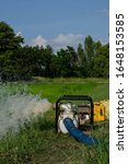 Small photo of Gasoline water pump recoil start and background is blue sky. Thai farmer are using to pump water for use in agriculture.