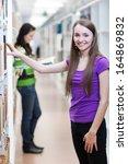 in the library   pretty  female ... | Shutterstock . vector #164869832