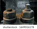 Two vintage hexagon nuts and screws of 19th century metalworking machinery - stock photo