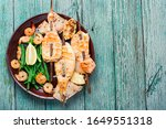 Small photo of Grilled squid on a skewer with a vegetables.Barbecue squids on a plate.