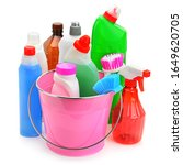 Small photo of Set of household chemicals and brushes for cleaning isolated on white background.