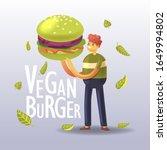 cartoon man holds a green tasty ...   Shutterstock .eps vector #1649994802